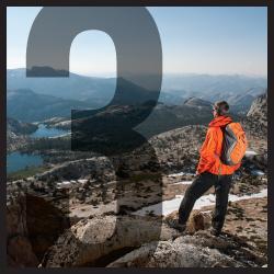 Man looking at high mountain lakes in Yosemite