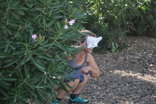 Girl Peeing behind a bush - if you are a perv and you are found this is a pervert search, gross.