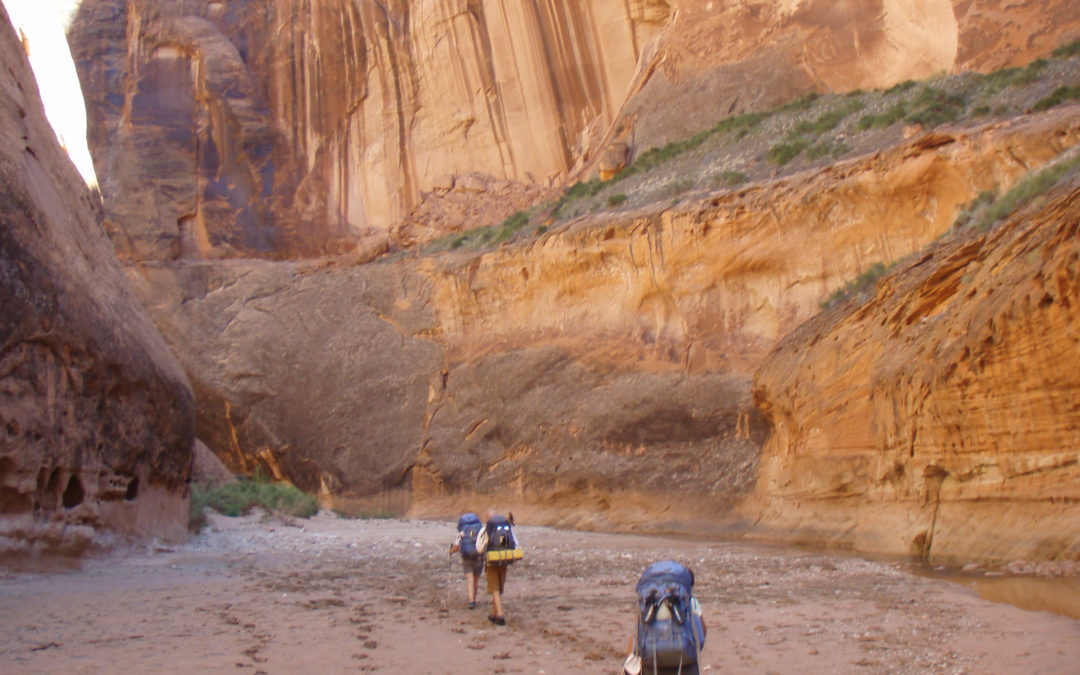 Backpacking entering the Paria Narrows in Paria Canyon